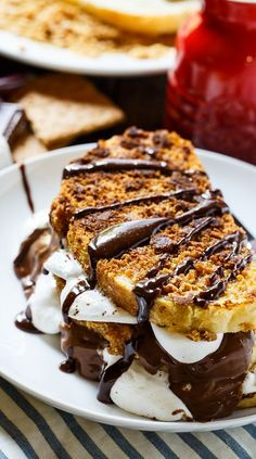 S'mores French Toast- coated in crushed graham crackers and stuffed with marshmallows and Hershey chocolate.