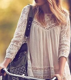 Love the edgy purse with the innocence of the lace shirt.