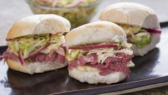 These Corned Beef and Cabbage Slaw Sliders are so good they'd knock the green and white socks off Old St. Pat himself.