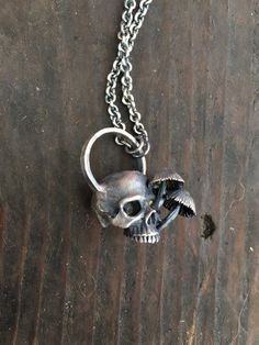 Sterling silver skull with little mushrooms on a sturdy continuous ombré oxidized Sterling chain.