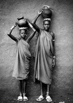 Bodi girls bringing milk Ethiopia by Eric Lafforgue