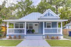Blue Cottage House Wide Terrace For Relaxation With Interior Designs House With Porch, Cottage Homes, House Exterior, Small Cottages, Porch Design, Colonial House, Small House, Cottage House Plans, Bungalow House Design