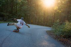 Longboarding with Original Skateboards Team Rider Max Vickers strikes a one foot pose off into the sunset on his Arbiter 36  Photo: Anthony Ruiz