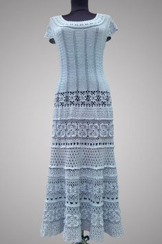 This handmade crochet dress is ultra feminine and aristocratic. Made of organic mercerized cotton in a fresh color with expertise and mastery. It