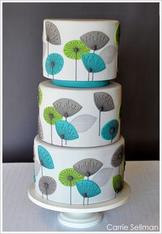 Inspired by a retro Dandelion Clocks Wallpaper, this Carrie Sellman design features three extra tall tiers covered in light grey fondant. Hand-cut fondant flowers in turquoise and bright green recreate the wallpaper pattern. The flower details and intri Gorgeous Cakes, Pretty Cakes, Cute Cakes, Amazing Cakes, Fondant Cakes, Cupcake Cakes, Modern Cakes, Cake Blog, Retro Flowers