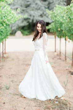 A long sleeve lace gown: http://www.stylemepretty.com/2016/06/20/steal-the-look-morgan-stewarts-glam-all-white-wedding/