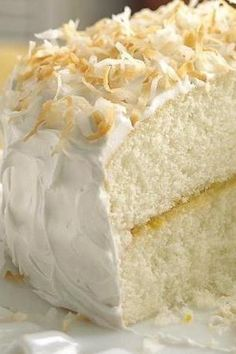 A delicious citrus-spiked cake all dressed up for Easter in white coconut.