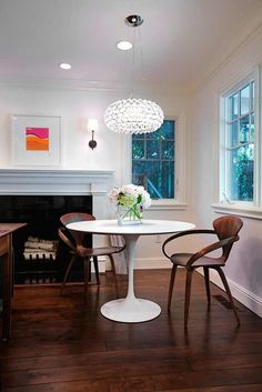 study:  midcentury Cherner chairs // Saarinen table // fireplace + mantel // floor stain // artwork // sconces