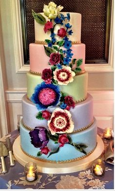 Love the rainbow color scheme with beautiful flowers cascading down the front. Crafted by Amy Beck Cake Design, Chicago, Illinois.