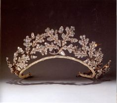 A tiara of oak leaves and acorns designed in the manner of ancient Greek jewelry, set with a profusion of brilliant-and rose-cut diamonds. Made by Garrard for the 15th Duke of Norfolk to give to his bride, Gwendolen Constable Maxwell as a wedding gift in 1904.