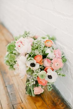 Whimsy Events & Design, Twin Cities Florists - Ranunculus, White Anemones, coral, pink, sage green, bridal bouquet - Whimsy Events & Design, Twin Cities Florists - Photo byWhitney Furst Photography