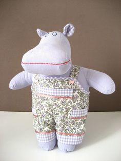 Marvell the Mippo - Handmade plush lilac hippo - Kids toy - Baby shower gift by Mippoos -||- Marvell the Mippo likes to play outside in his lilac floral dungarees. He doesn't care if he falls of the climbing racks, so keep an eye on him. ;) He is part of the Mippoos family but looking for a friend who will take him on adventures. If the little one is still too young, he might just be able to wait as nusery decor, so don't hesitate to give him a home as he is a wonderful baby shower gift!