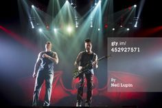 News Photo: Shadows and Synyster Gates of Avenged Sevenfold perform Wembley Arena, Dec 2013 | Getty Images