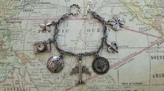 Check out this item in my Etsy shop https://www.etsy.com/listing/235933283/tim-holtz-souvenir-adornments-pewter