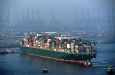 Container ship arrives at a loading terminal at the Port of Hamburg, Germany