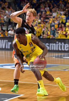 Will Cherry of ALBA Berlin handles the ball against Per Guenther of Ratiopharm Ulm during the game between Alba Berlin and ratiopharm Ulm on october 1, 2015 in Berlin, Germany.