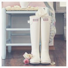 Whilst you can't rely on the weather in England, a pair of white wellies are sure to keep feet snug and dry at any wet #cotswoldwedding.