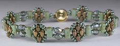 Link to Deb Roberti's free Stackers bracelet pattern done in pale turquoise and bronze. ~ Seed Bead Tutorials