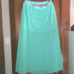 Sea foam colored maxi skirt. Elastic waist. Sea foam colored pleated maxi dress. Size XL. Offers only accepted through offer button. Skirts Maxi