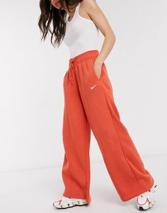 Nike mini swoosh high waisted wide leg joggers in red | ASOS Joggers, Sweatpants, Wide Leg, Asos, Cool Store, Still Working, Nike, Harem Pants, Red
