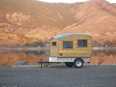 This small wooden home is perfect for road trips, car-camping, or to haul round the world. When mounted to a trailer frame, the possibilities for small custom campers are nearly endless
