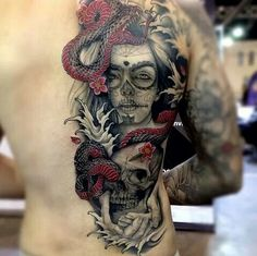 Day of the dead girl tattoo. Skulls. Snake. Women with ink.