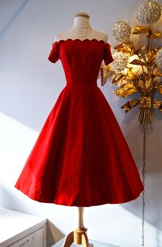 A smashing 1950s red velvet party dress with a scalloped neckline and off-the-shoulder sleeves by Johnny Herbert #1950s #red #christmas #dress