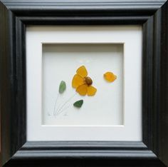 I love the pale orange colour off this stained sea glass flower. https://www.etsy.com/uk/listing/512595757/stained-sea-glass-flower-mothers-day?ref=listing-shop-header-1