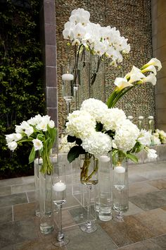 NOT exactly what i want, but somewhat similar in that I would like those long vases, and have blue/green hydreangeas cut long and submerge them in the water to be in the front of the ceremony room where the bride and groom will be standing for decoration. otherwise, we won't have anything.