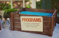 CDs with programs inside (possible wedding favor)
