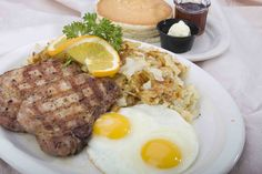 Pork chops with sunny side eggs , hashbrowns