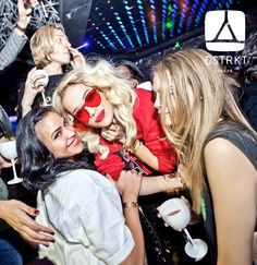 Rita Ora at DSTRKT London, someone Eshishin in the background.