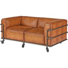 This Sofa Features A Simple Design With Rich, Light Brown Leather  Upholstery Encased In An Iron Pipe Frame With ...