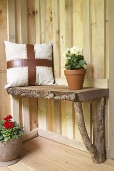 back door bench made from scrap lumber and supported by a locust branch
