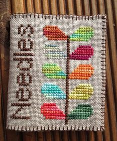 cross stitch needle book in variegated threads on natural line. Orla Kiely inspired | Flickr - Photo Sharing!