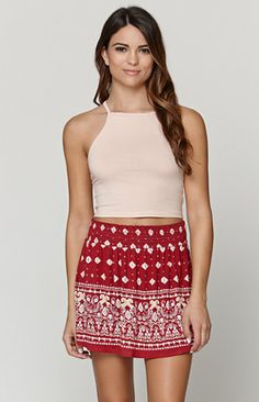 """TheSmocked Knit Swing Skirt by LA Hearts for PacSun and PacSun.com features a ruched elastic waistband for a totally comfortable fit. We love the print throughout and cute, casual style. Wear this skirt with our tanks and sandals this season!   15"""" length Measured from a size small Model is 5'9"""" and wearing a small 95% rayon, 5% spandex Imported"""