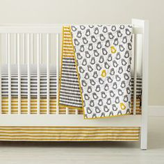 Our Not a Peep Crib Bedding will be the perfect starting point for the room. We'd suggest the striped options for the sheet and skirt, as shown here. A classic pattern in a trendy color palette.