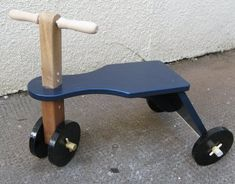 Child's Traditional Wooden Ride-on Toy