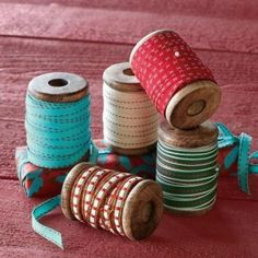 How I use my old wooden spools -- wrap ribbon around them, then store on a thread rack hanging on the wall of my sewing room: practical, decorative, & saving the old wooden spools.
