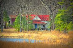 """Photo credit:  Scott Garlock Photography   """"Out in the Country"""" This little red roofed farm house in Granville County, NC is the center piece of a rural country scene. What caught my eye was the blue hues of the front door complimenting those of the pond, it just kind of pulled all the elements together. (2014)"""