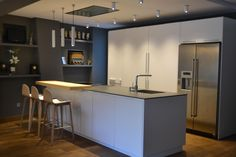 Santos INTRA Kitchen in Matt Lacquer with Sliding Door Larder Units hiding Ovens