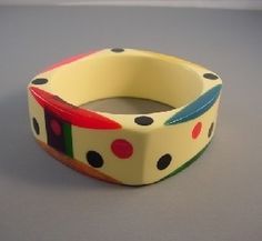 SHULTZ bakelite cream bakelite four-sided multi-colored confetti dots bangle with navy edge dots. by paulaqwest