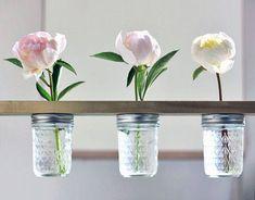 Hanging Flower Shelf: This makes a few simple buds go a long way. (via Shelterness)