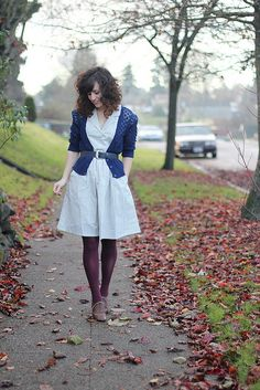 Blue and white striped dress with blue cardigan and wine tights and brown oxfords.