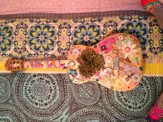 Old guitar decorated and turned into a fun piece of art for your home!