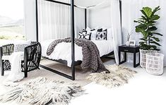 Uniqwa Furniture | our Strand Four Poster Bed in black with our Cocoa Tub Chair and Strand Pedestal Bedside Table. Photography: Uniqwa Furniture