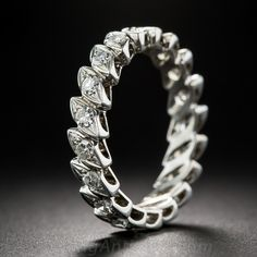 19 navette-shape settings each sparkle and shine with a single-cut diamond in this striking mid-century eternity wedding band crafted in gleaming 18K white gold. .75 carat total diamond weight. Ring size 7+.