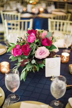This gorgeous centerpiece by Kate Foley Designs highlights the navy, berry and gold tones selected by MaryEllen and Lou! Amanda Jameson captured this modern and elegant wedding. Wedding Planner: Grit and Gold   Decor/Rentals: Posh Couture Rentals   Florist: Kate Foley Designs #bridesofnorthtx #centerpiece