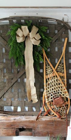 an antique tobacco basket gets dressed up with greens and a bow