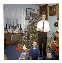 Christmas in the 60's. So nice to see people not wearing filthy pajamas and rags.